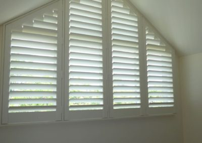 plantion shutters can cover a variety of odd shaped windows this one instaled in henley beach