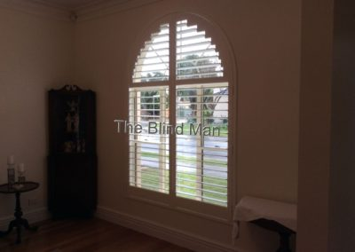 this arched plantation shutter was installed in Saint Marys