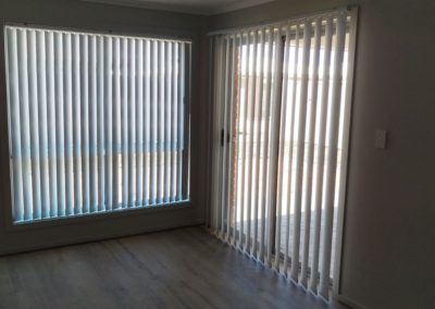 127mm vertical blinds - these vertical blinds are controlled by a wand and are also chain less on the bottom