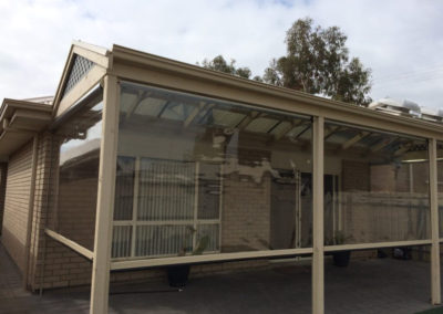 Keep the rain out with this made to measure clear PVC Zip screen installed in Payneham