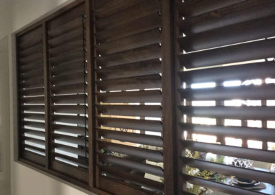 Plantation shutter in timber used as a room divider