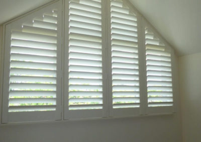 Plantation shutters on angled window - done for a Glenunga client's nursery room
