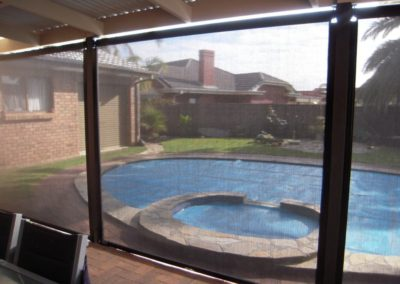 Zip screen blinds installed in a Happy Valley client's pool area