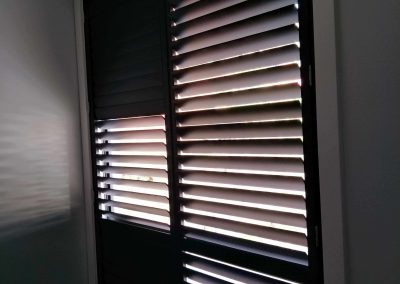 Black plantation shutters installed in Panorama