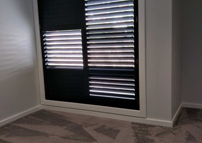 Black plantation shutters installed in Panorama_n