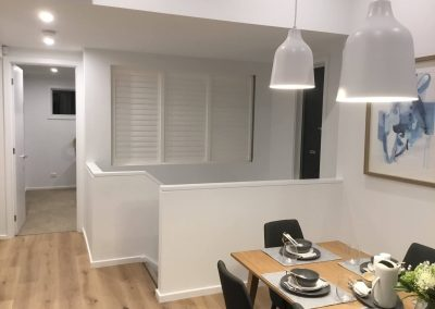 Plantation shutters are very diverse - We installed them in this Victor Harbour client's home for use as a room divider. When closed they give you privacy and when open they let in a lot more light.