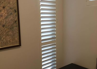 Plantation shutters installed in a Prospect client's bedroom